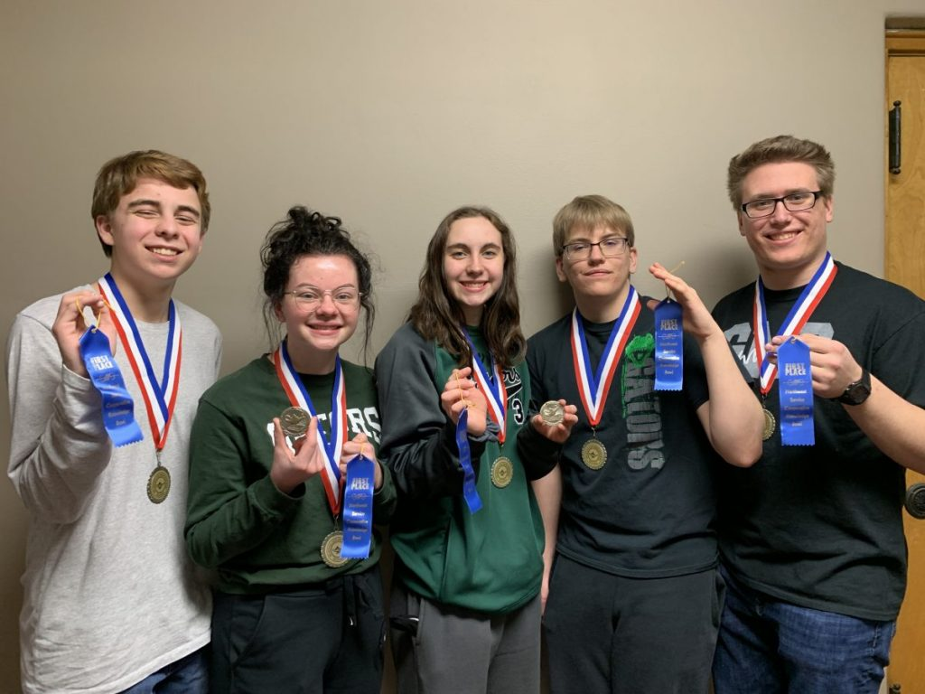 Greenbush-Middle River Knowledge Bowl team members hold and wear the awards they earned for finishing as region champions— an accomplishment the team hasn't earned since 1990, according to estimates, and one that advanced the team to the virtual state meet on April 8. Team members pictured include (L-R): Chance Christian, Olivia Brazier, Mariah Christian, Christian Wahl, and Ryan Hlucny. (submitted photo)
