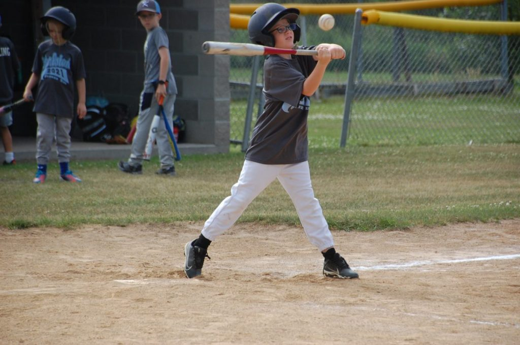 Elliot Sollund attempts to hit the ball during a Karlstad Summer-Rec T-Ball road game in Greenbush. (photo by Ryan Bergeron)