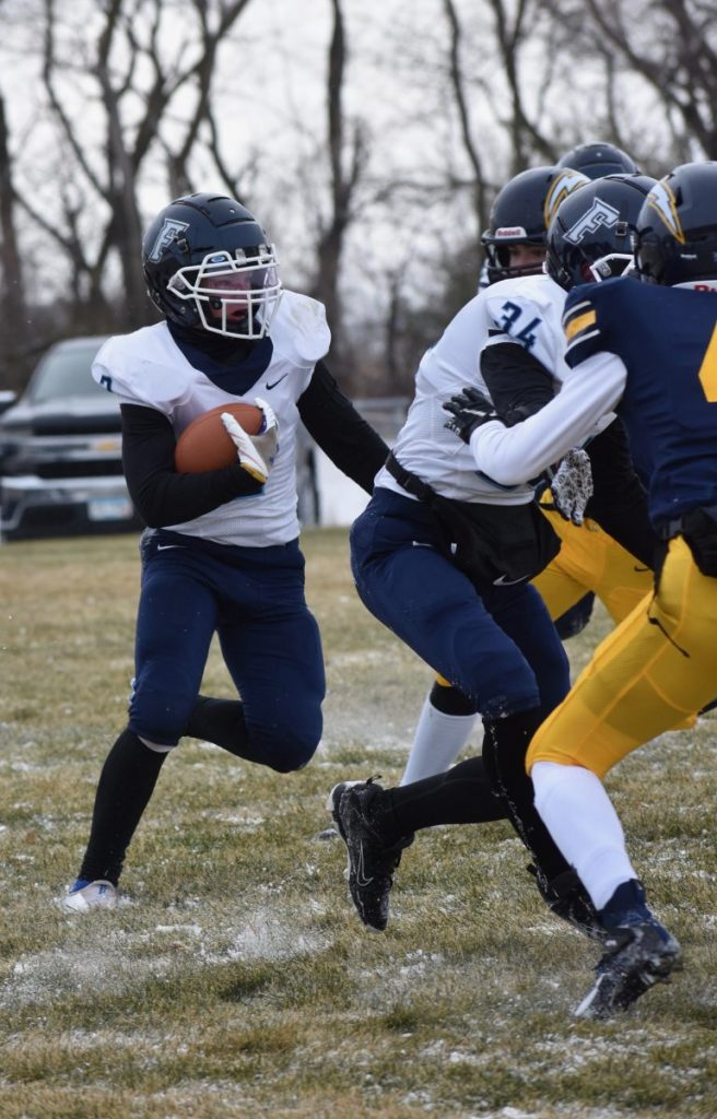 Nolan Bakke carries the ball during the Freeze's 34-13 road loss to the Stephen-Argyle Central Storm, a November 12, 2020 afternoon game in Argyle. (Photo by Jennifer Klegstad)