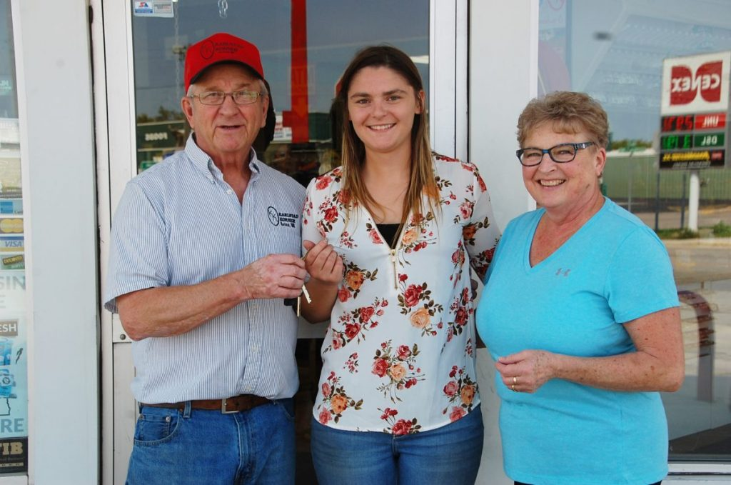 Hollis (left) and Carolyn Turnwall (right) officially hand over the keys of Karlstad Korner to the new owner Katey Cieklinski (center) on September 1. After owning this convenience store business together for about 20 years, Hollis and Carolyn have stepped back from a business that gave them daily interaction with the community. (photo by Ryan Bergeron)