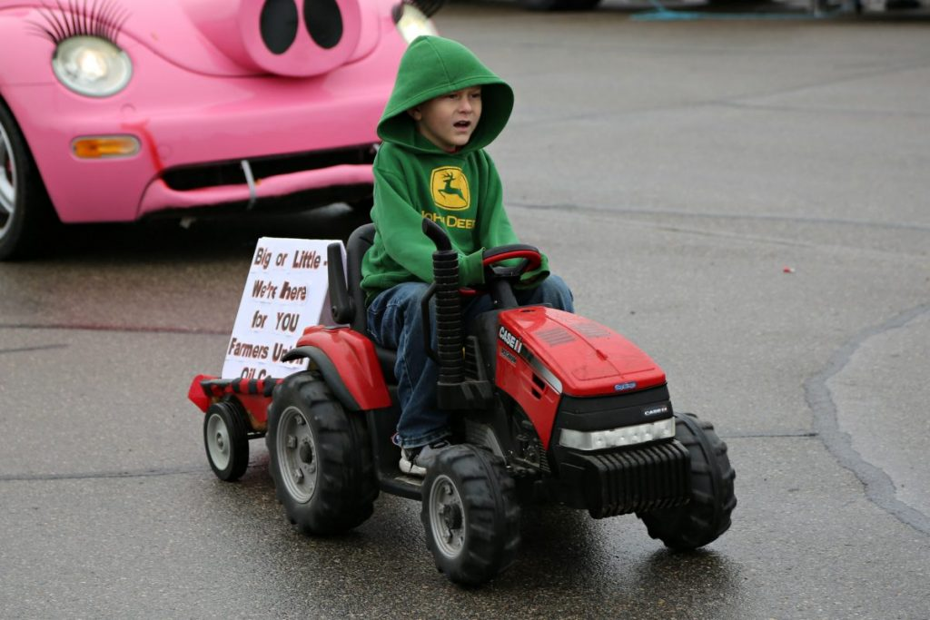 Advertising Farmers Union Oil Company, this young man drives his Case I-H Magnum in the Badger Fall Fest Parade back on September 16, 2017. (photo by Val Truscinski)